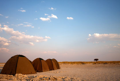 A series of tents on salt pans for wild camping